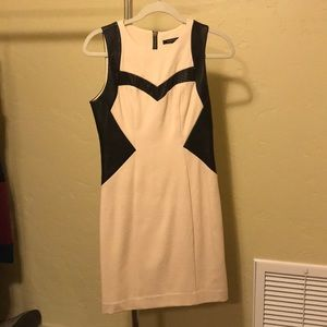 Sleeveless dress with leather trim size 2